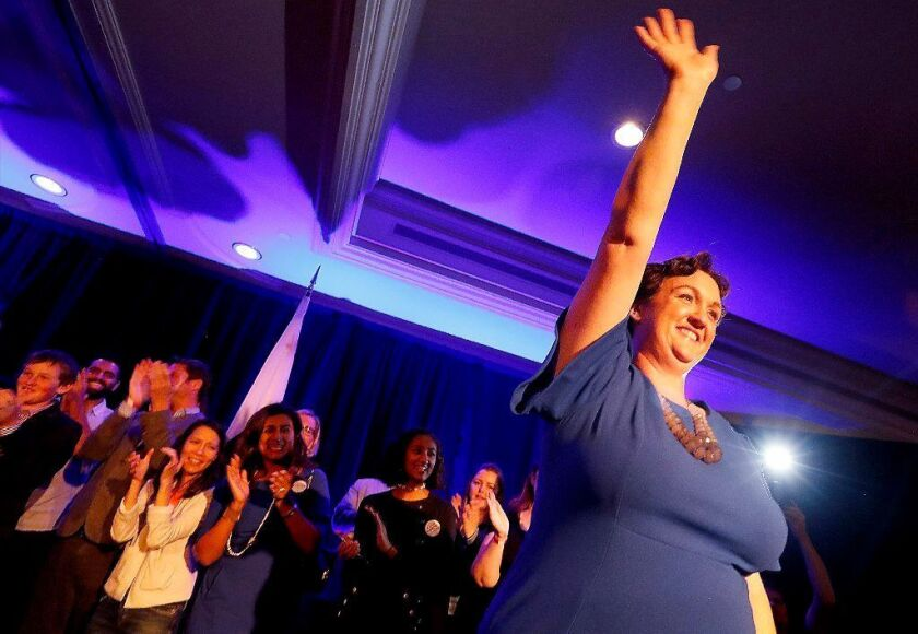 IRVINE, CALIF. .. - NOV. 6, 2018. Congressional candidate Katie Porter waves to supporters after giving a speech at a campaign party in the Irvine Hilton on Tuesday night, Nov. 6, 2018. (Luis Sinco/Los Angeles Times)