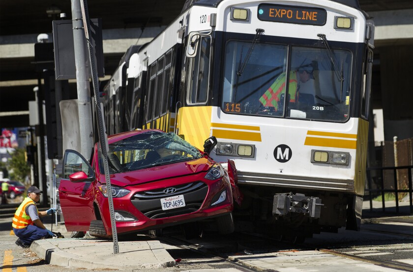 A Metro Expo Line train collided with a car knocking the front of the train off the tracks.