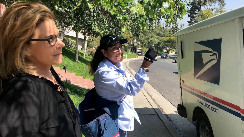ENCINO CA MAY 29,2018 -- Pam Sobo and mail carrier Veronica Solis say cut-through traffic has never