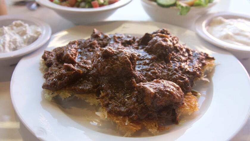 Fesenjoon over crispy rice at Dizin Persian Cuisine