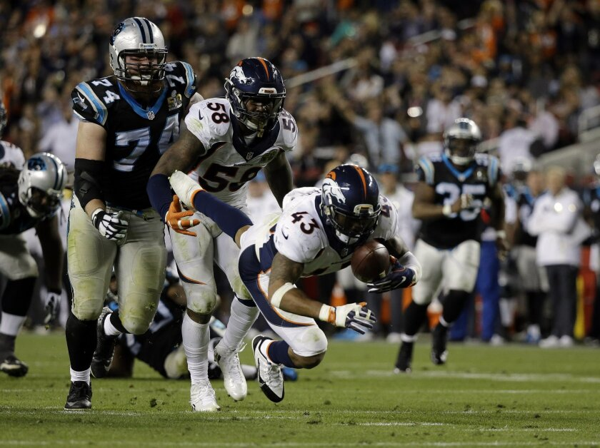 Denver Broncos' T.J. Ward (43) recovers a fumble during the second half of the NFL Super Bowl 50 football game Sunday, Feb. 7, 2016, in Santa Clara, Calif.  (AP Photo/Ben Margot)