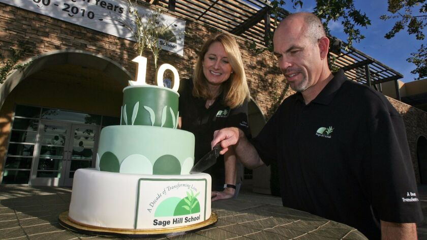 TEN YEARS IN THE MAKING – Head of School Gordon McNeill, and board chair Vicki Booth cut the Sage Hi