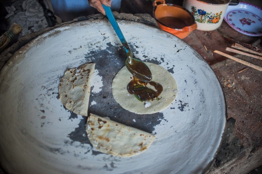 As part of the Puesto executive culinary team's trip to Oaxaca in March, the chefs learned how to make Empanadas de Mole on a comal cured with limestone water in a traditional outdoor, wood-fired kitchen.