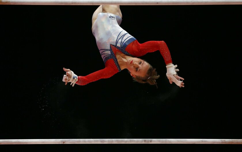 Madison Kocian of the U.S. performs on the uneven bars during the women's apparatus final competition at the World Artistic Gymnastics championships at the SSE Hydro Arena in Glasgow, Scotland, Saturday, Oct. 31, 2015. (AP Photo/Matthias Schrader)