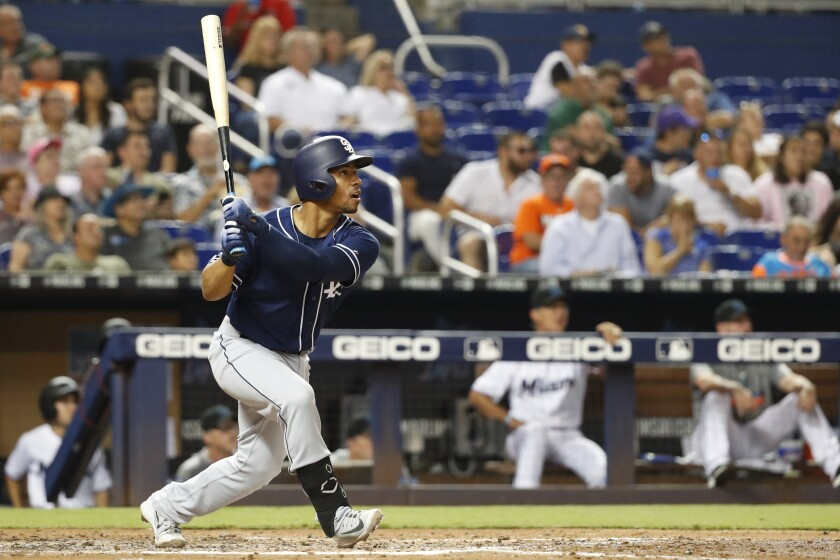 Padres catcher Francisco Mejia bats against the Miami Marlins on Tuesday.