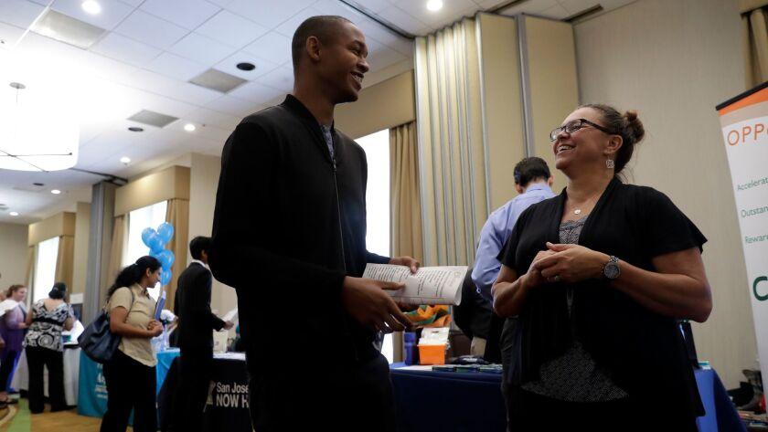 Big 5 Sporting Goods recruiter Kathy Tringali talks to applicant Jarrell Palmer at a job fair in San Jose.