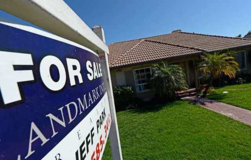 "A ""For Sale"" sign posted at a home in Los Angeles. Home prices in July jumped the most in six years."