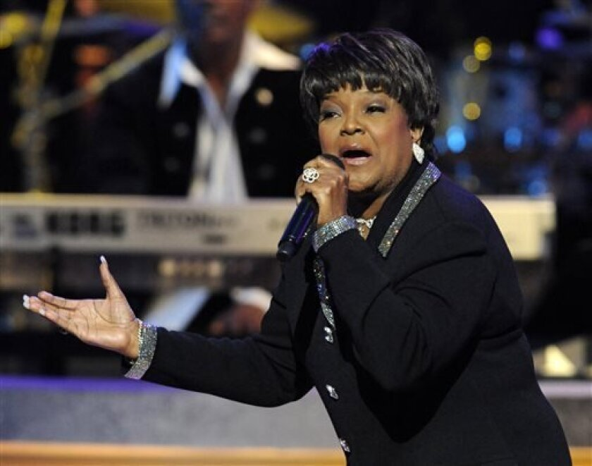 """FILE - This Dec. 15, 2007 file photo shows 11-time Grammy winner and pastor Shirley Caesar performing at BET network's Annual Celebration of Gospel concert in Los Angeles. Caesar, who is known as the """"Queen of Gospel,"""" is singing to a different tune on her new solo album, """"Good God,"""" released last week. It has been four years since she dropped an album, giving her time to embrace a new musical approach. The 74-year-old Caesar brought on up-and-comers Kurt Carr and James Fortune as producers to i"""