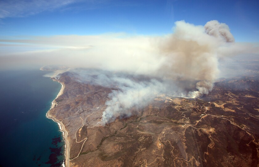 An aerial view of the Springs fire burning in the Santa Monica Mountains between Malibu and Newbury Park is shown.