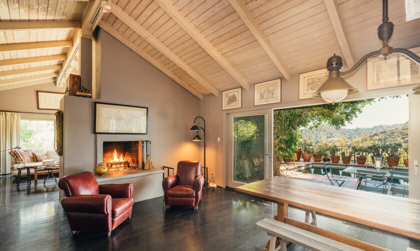 The Laurel Canyon area house that Stockard Channing has listed features gardens in front and a backyard pool and spa.