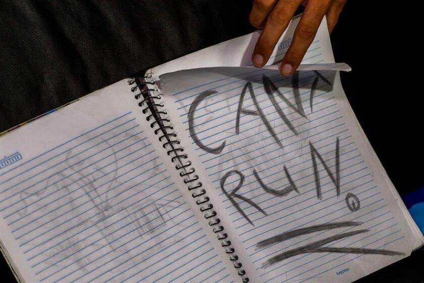 """Photograph of a notebook that reads """"You can not run"""" found in the vehicle Guilherme Taucci Monteiro and Luiz Henrique de Castro, authors of a massacre on March 14, 2019 in Sao Paulo, Brazil. EPA-EFE"""