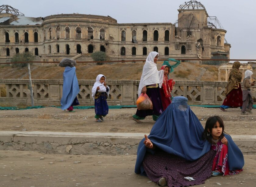 Afghan women were prohibited from going out in public without a male relative escort during the 1996-2001 era of Taliban rule, and girls were barred from attending school. A delegation of legal experts working on a new penal code has proposed a return to sharia law, including death by public stoning for moral crimes like adultery.
