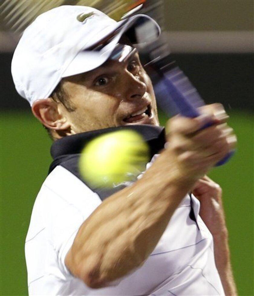 Andy Roddick returns to Roger Federer, of Switzerland, during the Sony Ericsson Open tennis tournament in Key Biscayne, Fla., Monday, March 26, 2012. Roddick won 7-6, 1-6, 6-4. (AP Photo/Alan Diaz)