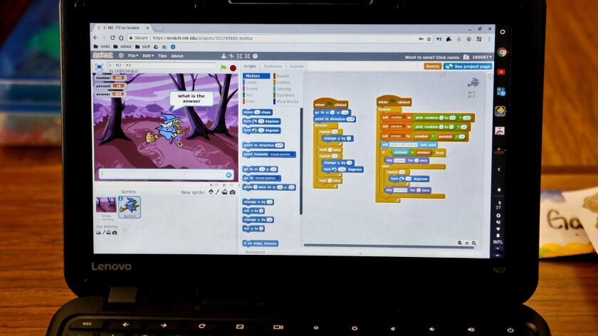 Adams Elementary School sixth graders use the Scratch program during CodeCampus coding class at the
