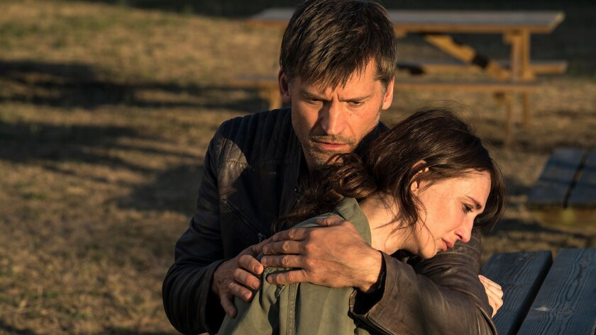 (L-R)- Nikolaj Coster-Waldau as Christian and Carice van Houten as Alex Boe in the thriller DOMINO.