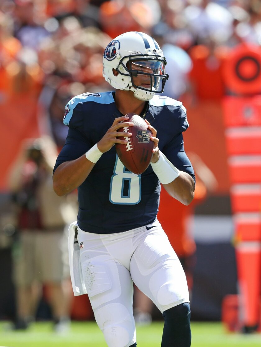 FILE - In this Sept. 20, 2015, file photo, Tennessee Titans quarterback Marcus Mariota (8) looks to pass against the Cleveland Browns during an NFL football game, in Cleveland. Mariota appears set to return after missing two weeks with a sprained MCL in his left knee. The Titans quarterback could b