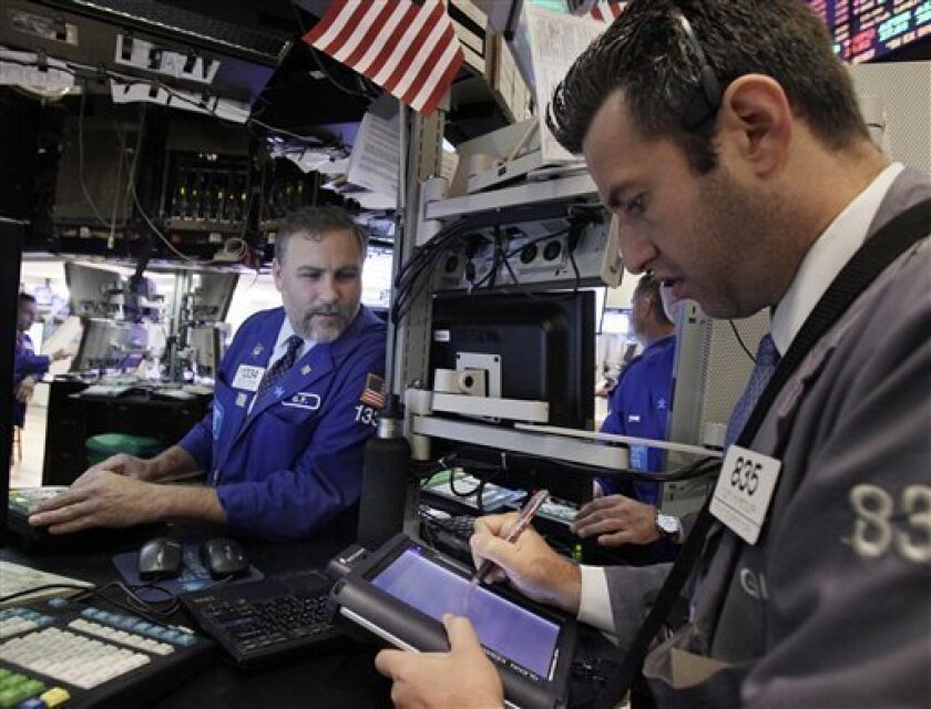 In this Aug. 29, 2011 photo, traders work on the floor of the New York Stock Exchange. Stocks advanced for the second day running Thursday, Sept. 8, 2011, amid hopes that global policymakers will enact more measures to shore up ailing economic growth.(AP Photo/Richard Drew)