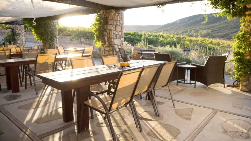 Vineyard Grant James's tasting patio offers views of the grape vines and surrounding hills.