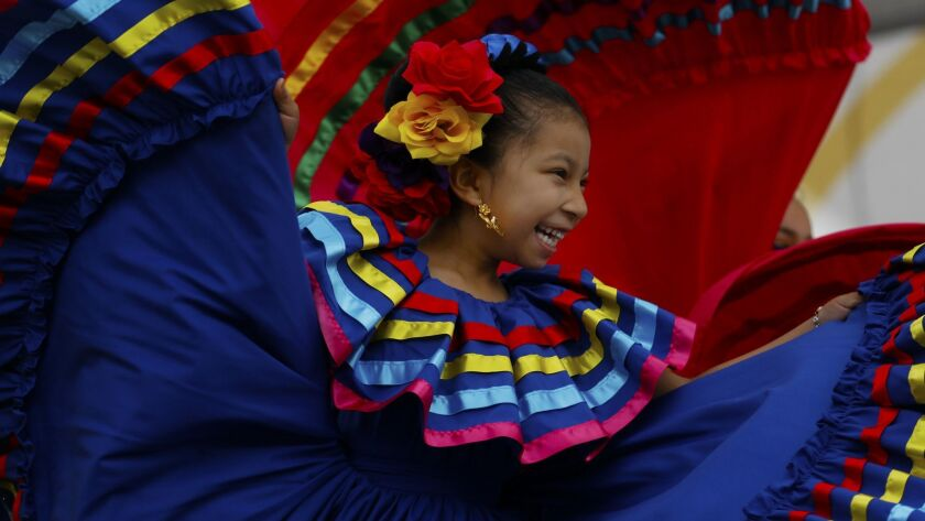LOS ANGELES, CA APRIL 29, 2018: Folklorico dancer Sarahi Mendez, age 6, with 'Gary Ferrer & St Joh