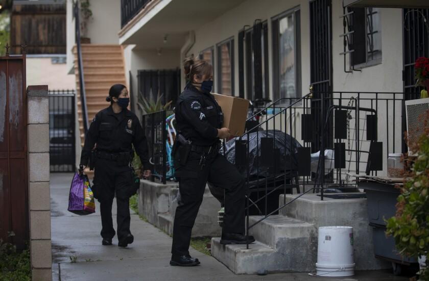 LAPD officers delivering food