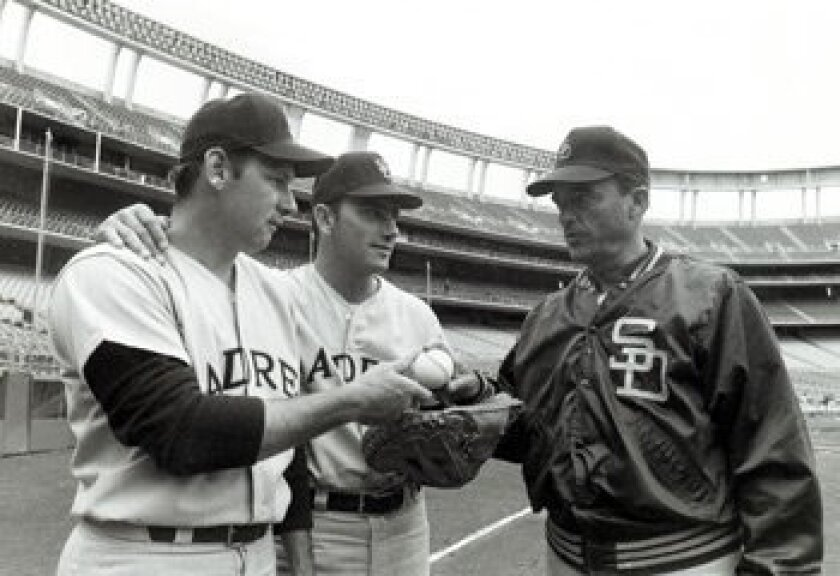 The Padres' first manager, Preston Gomez (right) poses with opening day pitcher Dick Selma (left) and catcher Chris Cannizzaro before the Friars' first game in April, 1969. Gomez died Jan. 13, 2009.