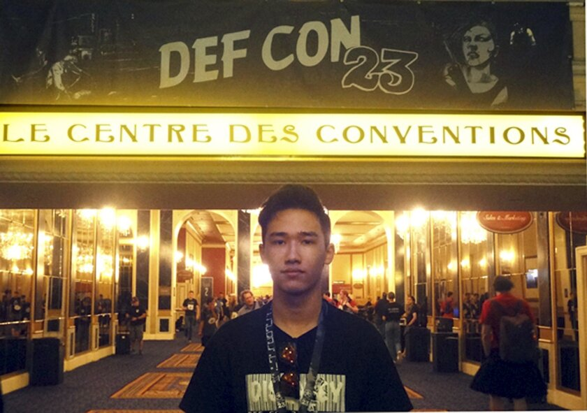 This August 2014 photo provided by Shu Chien shows her son Moshe Kai Cavalin at the DEF CON 23 hacker's conference in Las Vegas. Cavalin, of San Gabriel, Calif., earned a bachelor's in math from UCLA at age 15, and is taking online classes through Brandeis University, near Boston, towards a master'