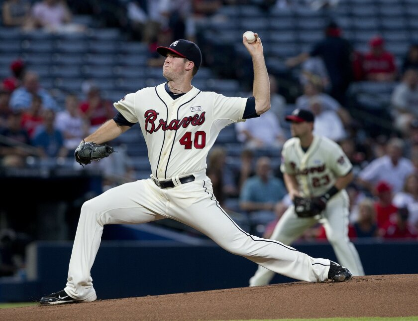 Atlanta Braves starting pitcher Alex Wood works in the first inning of a baseball game against the Washington Nationals Sunday, Aug. 10, 2014 in Atlanta. (AP Photo/John Bazemore)