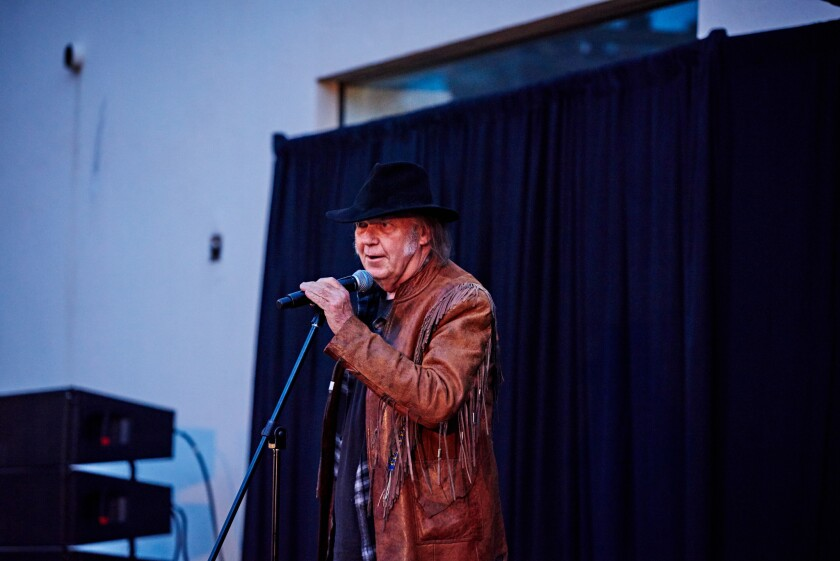 Neil Young briefly addresses the audience, estimated at 2,500, at the Natur