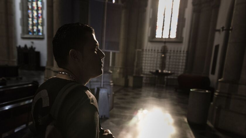 São Paulo, Brazil. Luis Baena, 42, visiting the Sé Cathedral to pray and thank for his new life.