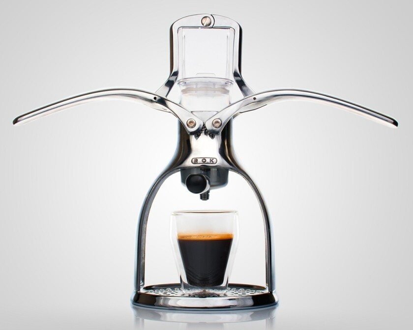 It's a manual-pressure coffee maker made with engine-grade metal, fitted with two arms that you raise and then lower to pull a shot of espresso (it generates five to nine bars of pressure, depending on your technique, according to the manufacturer).