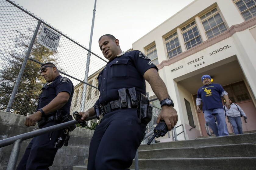 Los Angeles School Police Officers Frank Avelar, left, and Jose Zamora leave Breed Street Elementary after conducting a safety check.