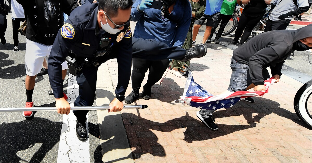 Photos: Rival demonstrators protest during a white lives matter rally at Huntington Beach – Los Angeles Times