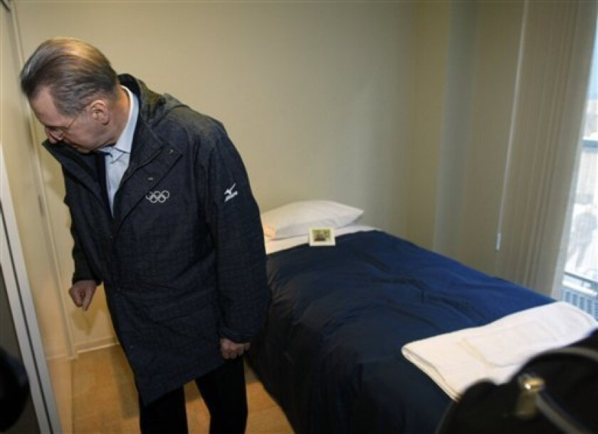 International Olympic Committee President Jacques Rogge looks around a room at the Olympic Village at the Vancouver 2010 Olympics in Vancouver, British Columbia, Tuesday, Feb. 9, 2010. (AP Photo/Marcio Sanchez)