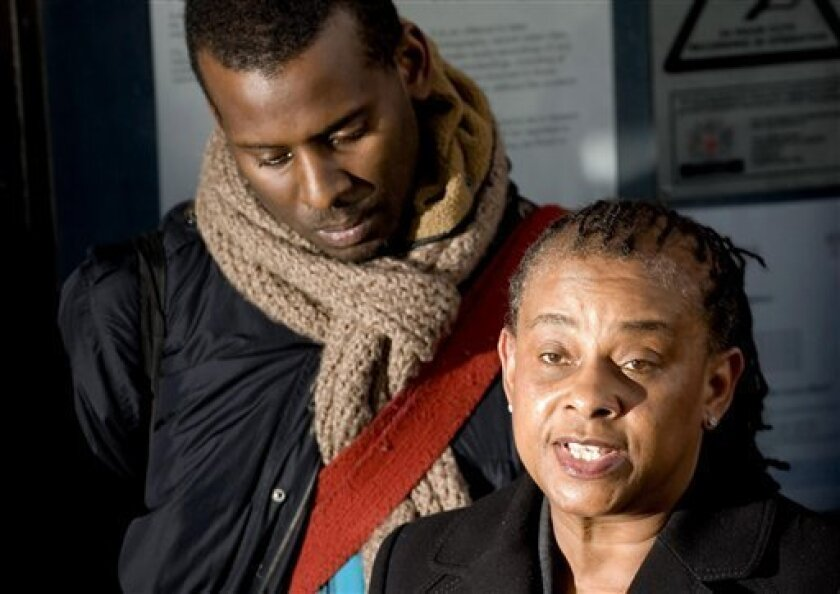 "Stephen Lawrence's mother Doreen Lawrence speaks to the media outside the Old Bailey in central London Tuesday Jan 3 2012, following the conviction of Gary Dobson, 36, and David Norris for the racist murder of her teenaged son in 1993. The case _ which has seen multiple court cases but no convictions until now _ led to strong criticism of London's Metropolitan Police and resulted in an investigation that found that the force was ""institutionally racist"". (AP Photo/ Dominic Lipinski/PA ) UNITED KINGDOM OUT - NO SALES - NO ARCHIVES"
