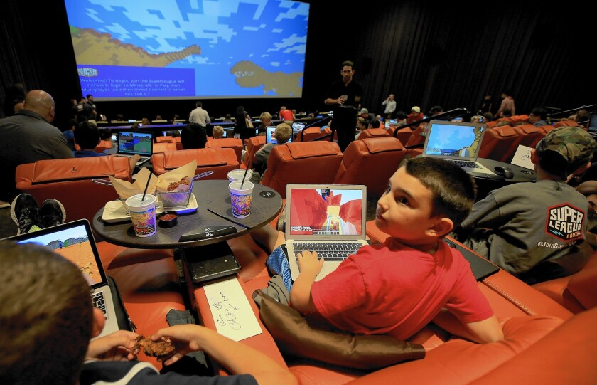"""Fans of the video game """"Minecraft"""" gather at the iPic theater in Westwood for an event sponsored by Super League Gaming."""