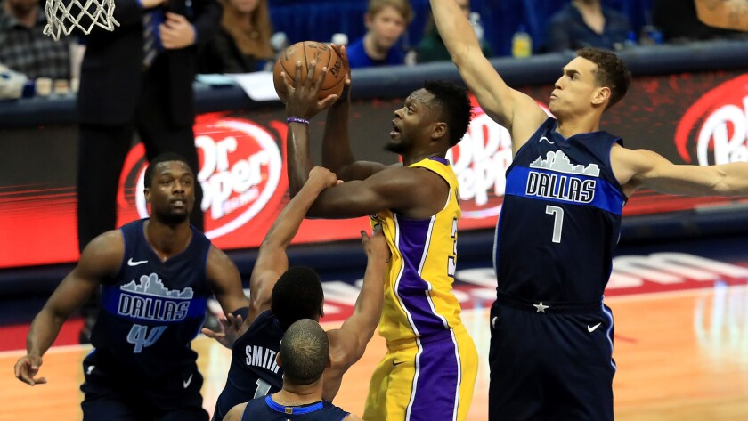Lakes forward Julius Randle tries to power his way to the basket against the Dallas Mavericks on Saturday. He finished with 23 points.