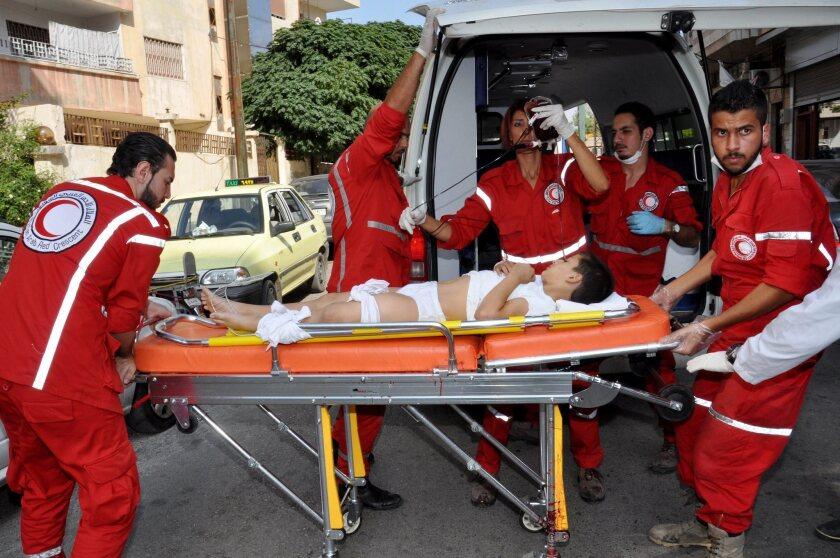Two bombs in Homs target schools