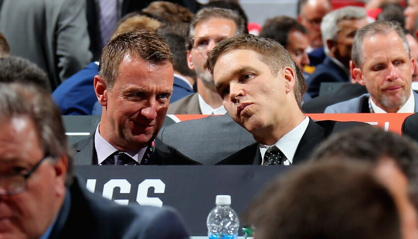 Kings general manager Rob Blake and team president Luc Robitaille talk at the 2017 NHL draft.
