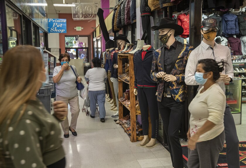 Shoppers on Monday at Plaza Mexico, a mall in Lynwood.