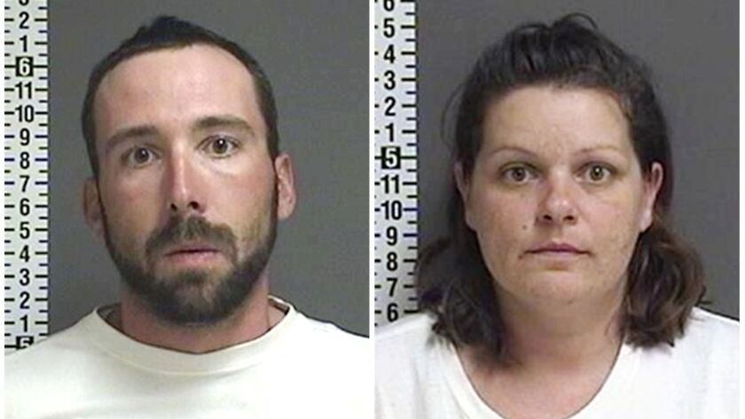 This combination of file photos provided by the Cass County Sheriff's Office in Fargo, N.D., shows William Hoehn, and his girlfriend Brooke Crews, the two people charged in connection with the slaying of Savanna Greywind in North Dakota in August 2017.
