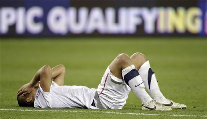 Terrence Boyd of the United States lies on the field after the United States tied 3-3 with El Salvador in a CONCACAF Olympic qualifying soccer match on Monday, March 26, 2012, in Nashville, Tenn. El Salvador scored in extra time to cause a 3-3 draw, eliminating the United States from Olympic qualifying. (AP Photo/Mark Humphrey)