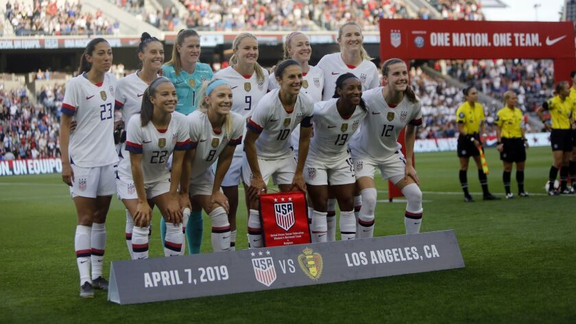 Members of of the U.S. women's national soccer team pose before the start of their game against Belgium at Banc of California Stadium on April 7.
