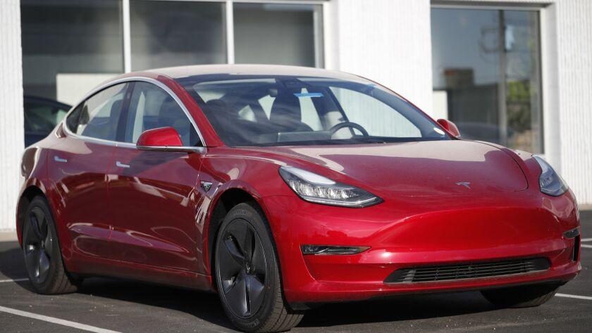 A Model 3 sedan at a Tesla dealership in Littleton, Colo., in May.