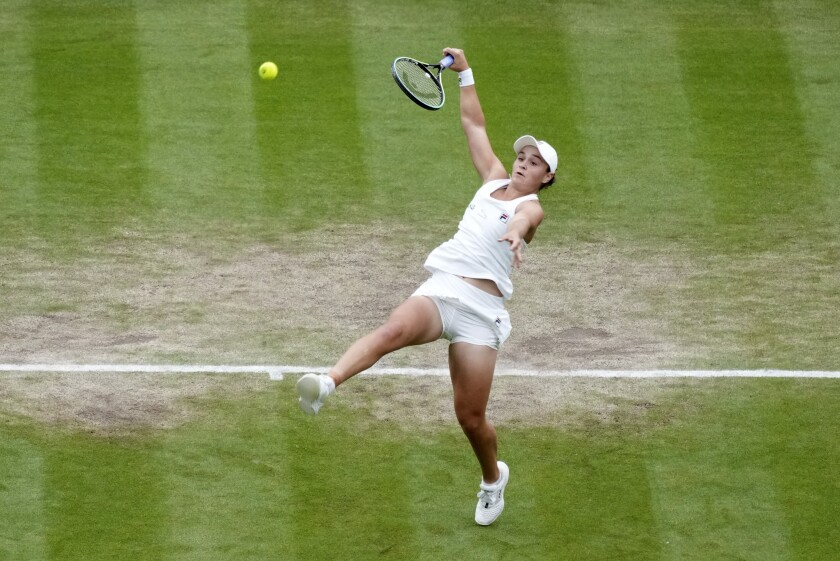 Australia's Ashleigh Barty plays a return to compatriot Ajla Tomljanovic during the women's singles quarterfinals match on day eight of the Wimbledon Tennis Championships in London, Tuesday, July 6, 2021. (AP Photo/Alberto Pezzali)
