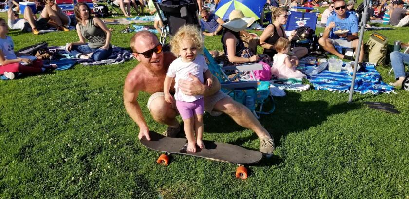 Tommy and his little skater buddy 'RaRa' prepare to take a cruise down the grassy hill.