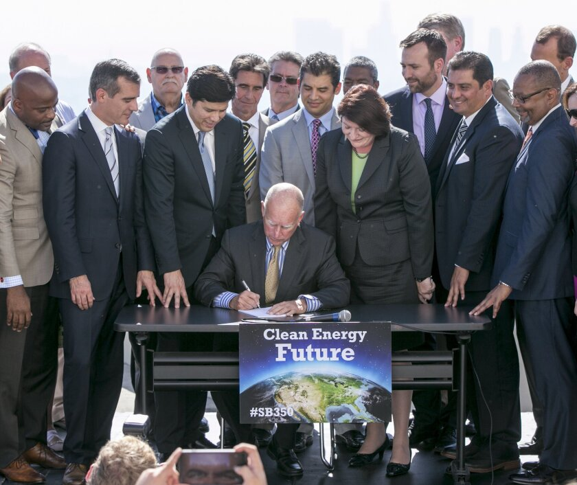 Gov. Jerry Brown signs climate-related legislation on Wednesday in Los Angeles. He signed additional environmental measures into law Thursday.