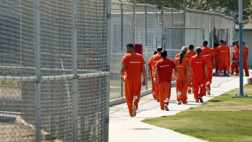 Inmates walk through the yard at the Lerdo jail facility in Bakersfield in 2014. A two-hour riot broke out there this week, leaving four inmates hospitalized.