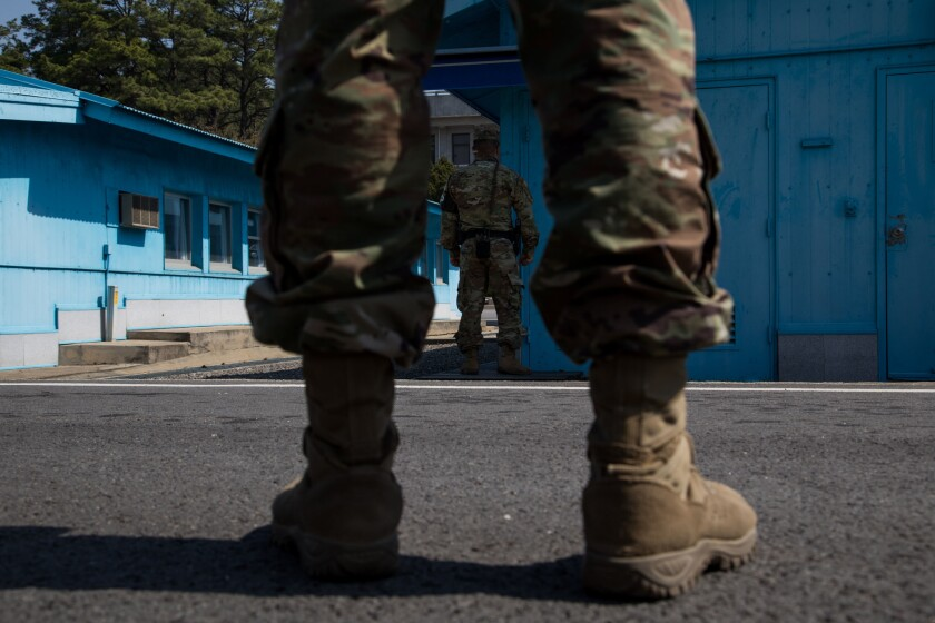 U.S. soldiers stand guard next to the United Nations Command Military Armistice Commission (UNCMAC) conference buildings at the truce village of Panmunjom in the Demilitarized Zone (DMZ) in Paju, South Korea, on April 18, 2018.