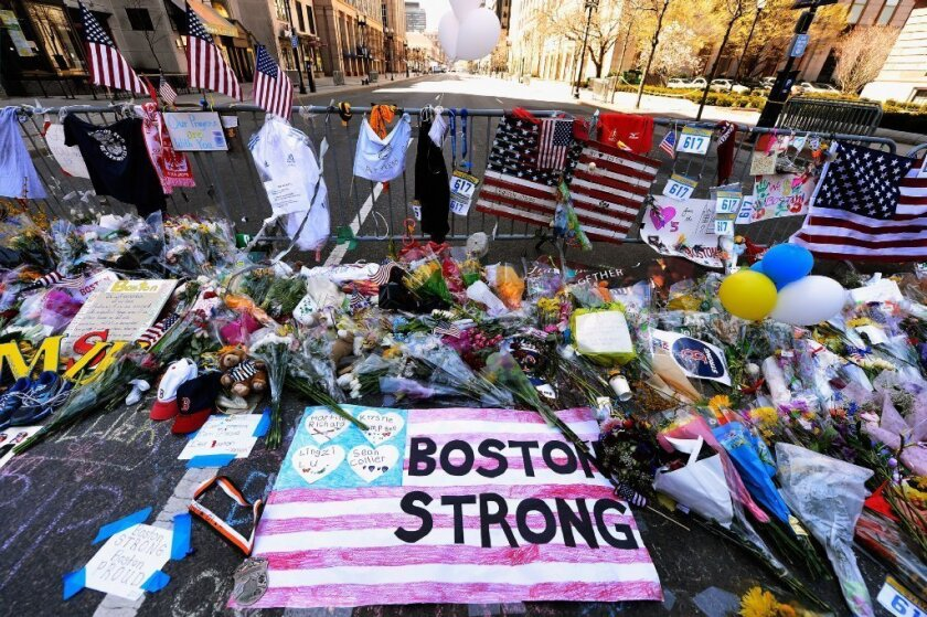 A makeshift memorial near the site of the Boston Marathon bombings at the intersection of Boylston Street and Berkley Street has been moved as city officials prepare for the reopening of the blast site.