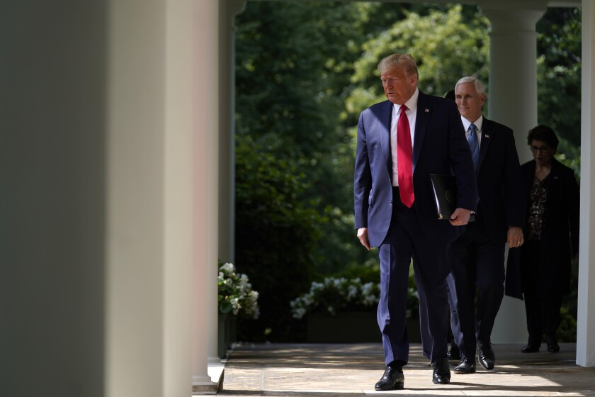 President Donald Trump arrives to speak at a news conference in the Rose Garden of the White House, Friday, June 5, 2020, in Washington. Vice President Mike Pence and Small Business Administration administrator Jovita Carranza are at right. (AP Photo/Evan Vucci)